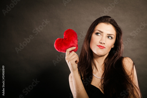 Billede Beautiful woman holds red heart on black