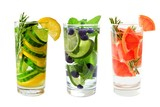 Three types of fruit detox water in glasses isolated on a white background