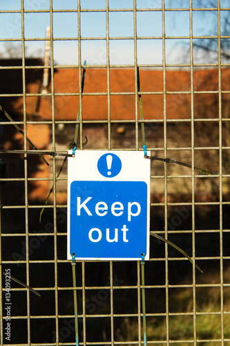 Poster Keep out sign tied to wire fence