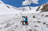Girl with ice ax on glacier