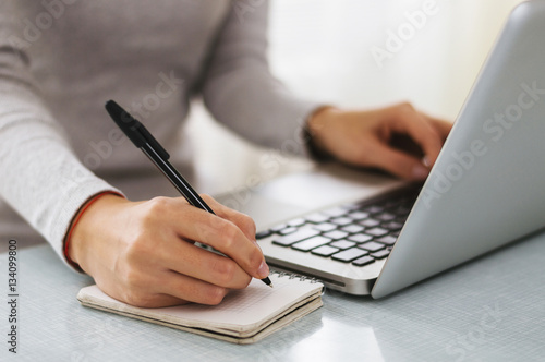 Poster Businesswoman hand working with new modern computer and writing
