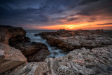 Catching the sunrise / Magnificent sea sunrise at the rocky coast near Shabla, Bulgaria