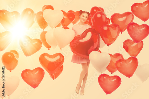 Beautiful girl, stylish fashion model with balloons in the shape Poster