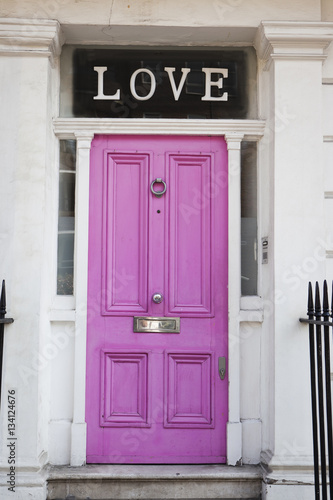 Poster Pink door with letters 'LOVE' found on a house in Chelsea, London, United Kingdom