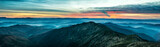 Panorama with blue mountains and hills at sunset - 134130628