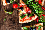 Hot pizza slice with Pepperoni, melting cheese on a rustic woode - 134133285