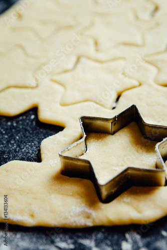 Poster Metal star-shaped form placed in cookie dough.