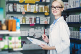 woman pharmacist is holding a notepad - 134140092