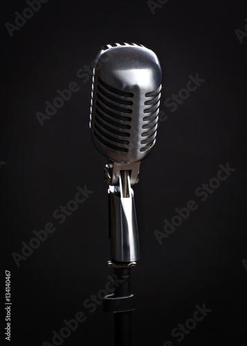 Staande foto Muziekwinkel Vintage microphone on black background