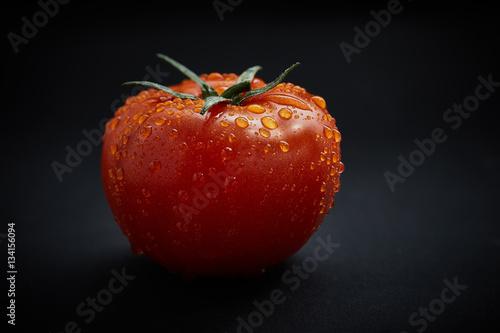 Fresh tomato on black background Poster