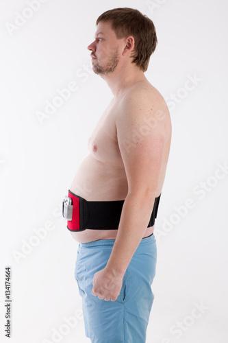 Poster man trains using electric slimming belt