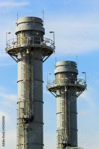 Gas turbine electrical power plant at dusk with blue sky Poster