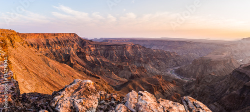 In de dag Oranje eclat Fish River Canyon, scenic travel destination in Southern Namibia. Last sunlight on the mountain ridges. Wide angle view from above.