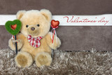 Teddy bear with red hearts wishes you a happy Valentines day