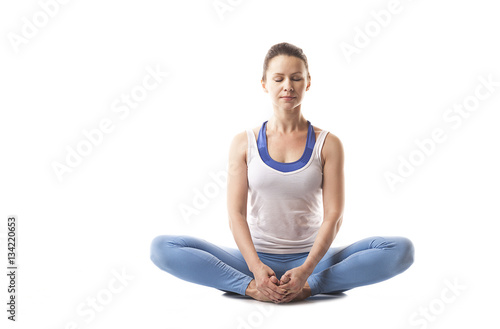 Obraz na płótnie Young girl engaged in yoga and gymnastics. White background.
