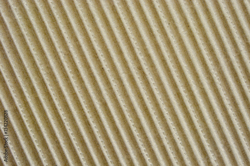 Сorrugated cardboard texture. Coarse surface finish. Fluted packing paper board with big waves.