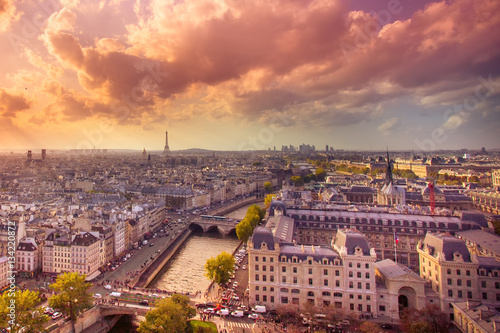 Sunset view across the city of Paris Photo by littleny