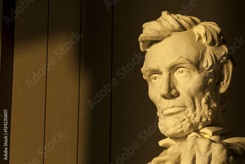 Statue of Abraham Lincoln in brilliant warm dramatic morning sunlight Poster