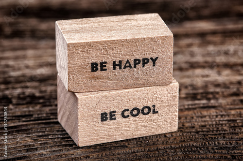 Poster Be happy and be cool text on  wooden cubes on  wood background