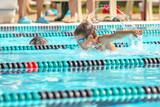 Boy swimming Butterfly in a race - 134236410
