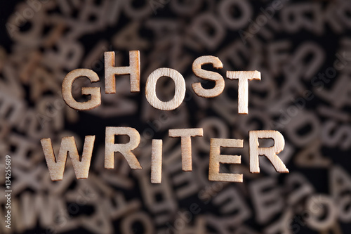 Poster Ghostwriter text in wooden letters floating above random letters out of focus