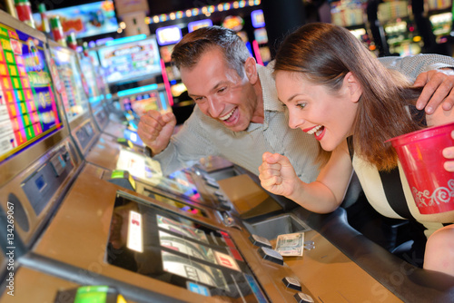 Poster Couple willing slot machine victory