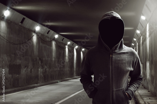 Hacker standing in the tunnel Plakát