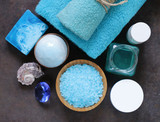 Spa concept turquoise - soap, salt, cream, towel
