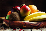 Healthy food: fruit set on the tray, vintage wooden background,