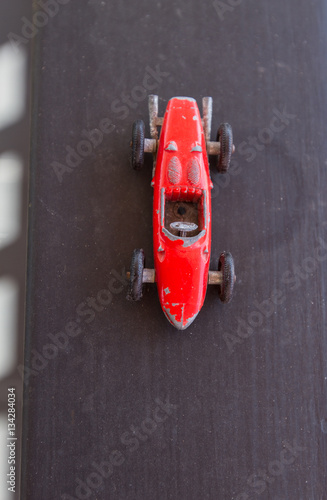 Poster Old red formula one car miniature, vintage and collection, touch of nostalgia