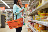 woman with food basket at grocery or supermarket - 134299277