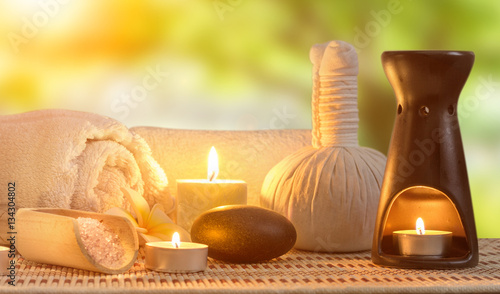 spa burning candles and zen stone