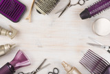 Fototapety Hairdresser tools on wooden background with copy space in center