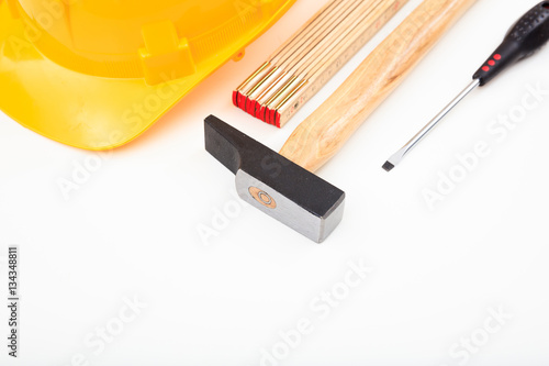 Poster Hard hat and tools on white background