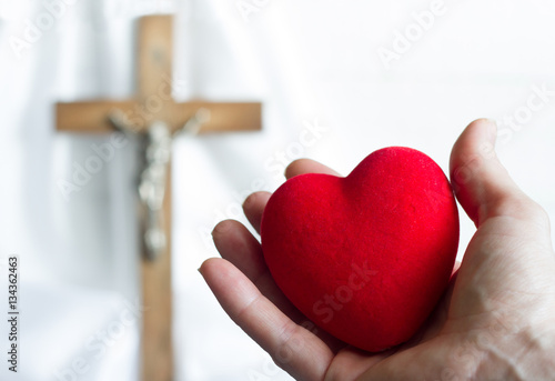 Poster Giving heart to Jesus abstract concept with easter cross on a white background