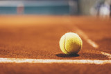 Yellow tennis bal on empty court, blurred background with area for your text message or content