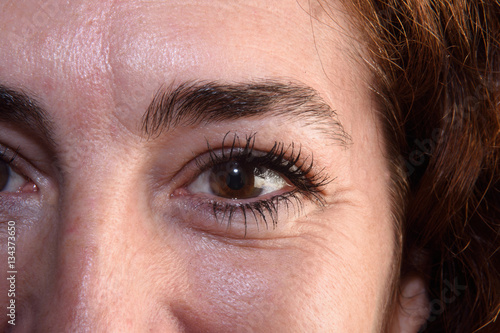 Poster Detail of wrinkles in a woman's eyes