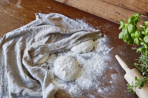 Aluminium Pizzeria resting dough pieces under kitchen towel