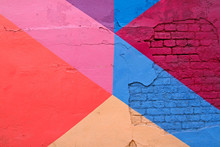 Colorful (purple, blue pink and beige) brick wall as background, texture