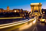 Evening traffic on Suspension Bridge in Budapest, toned image