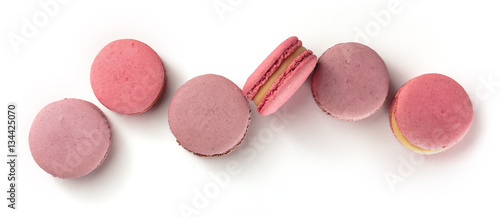 Fotobehang Macarons Pastel coloured macarons forming a row on white