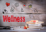 Wellness Concept. Stack of books and a stethoscope on a wooden background.