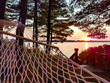Colorful Summer Sunset Landscape with Relaxing Hammock by the Lake