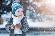 Adorable little boy having fun on winter day