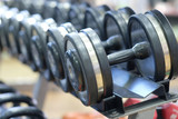 The image of dumbbells in fitness hall