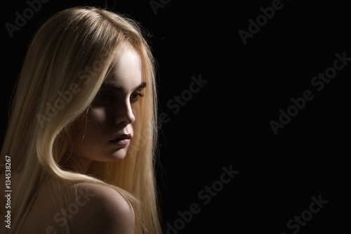 Poster beautiful girl portrait with long blond hair