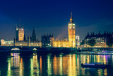 Iconic view Westminster with Big Ben, Houses of Parliament and Thames at Victoria Embankment lit up at night.