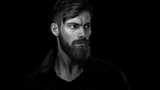 Fototapety Black and white portrait of bearded handsome man in a pensive mo