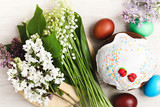 Easter cake with sugar icing and lily of the valley, top view
