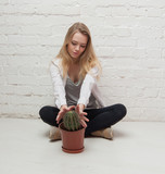 girl holding a cactus